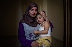 2 / Syrian refugee, Dayane, 24, holds her daughter Yemen, 5, who was severely burned in an accident with scalding water during a bombing raid in Yarbroud, Syria. The family fled to northern Lebanon six days after the accident but they could never afford treatment for Yemen. Six months on, the little girl is still in great physical pain, with some of her wounds unhealed, and she is still clearly traumatized. / UNHCR / Andrew McConnell