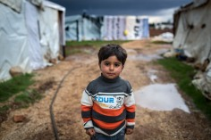 For the first 18-months of his life, Ashraf grew up in the city of Homs as the violence escalated in Syria, forcing millions to flee their homes. When close relatives were killed, his family decided to flee to Lebanon and made their home in this settlement. UNHCR / A. McConnell / March 2014